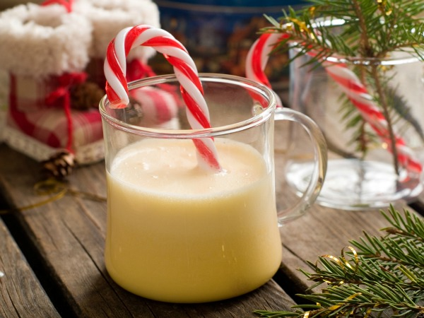 Eggnog with candy stick at christmas time, selective focus