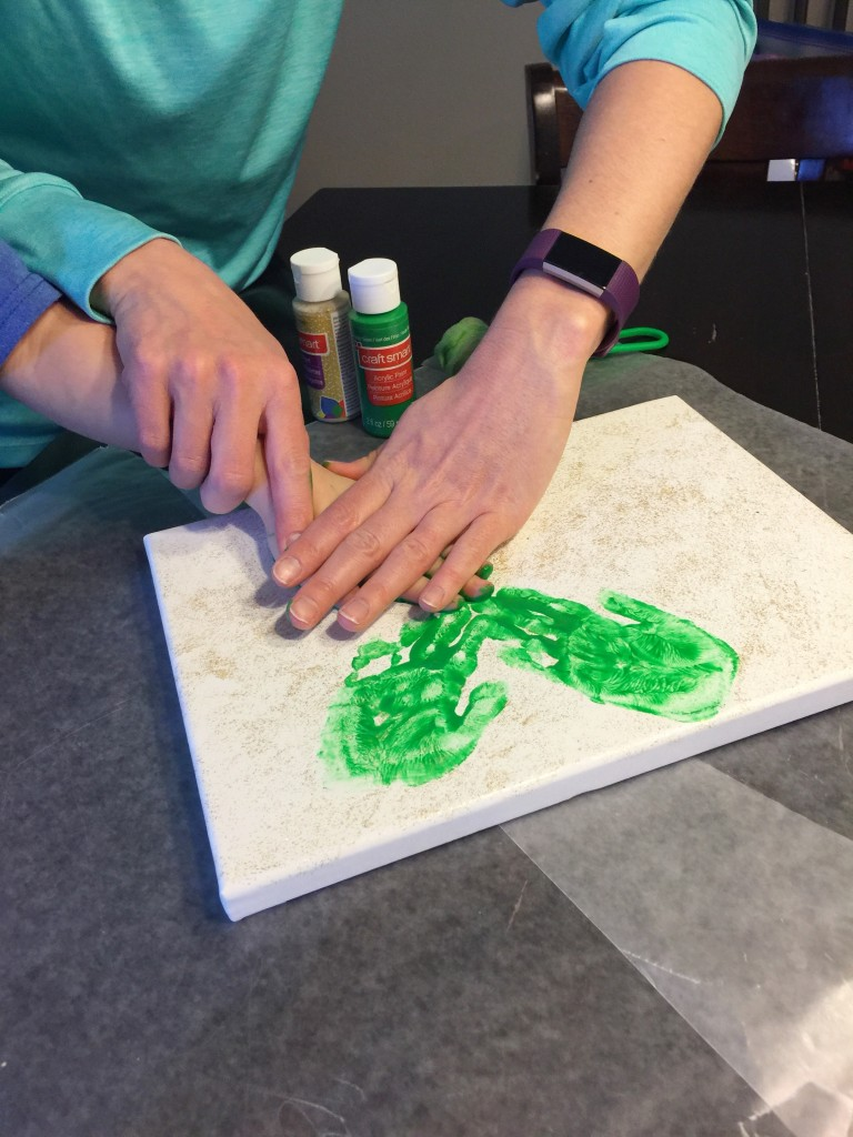 Stamping a Handprint for St. Patricks Day Craft