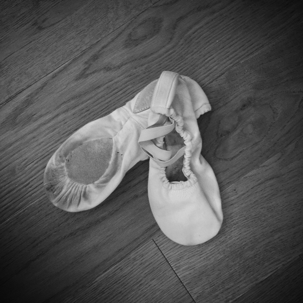 Ballet Shoes on Wood Floor