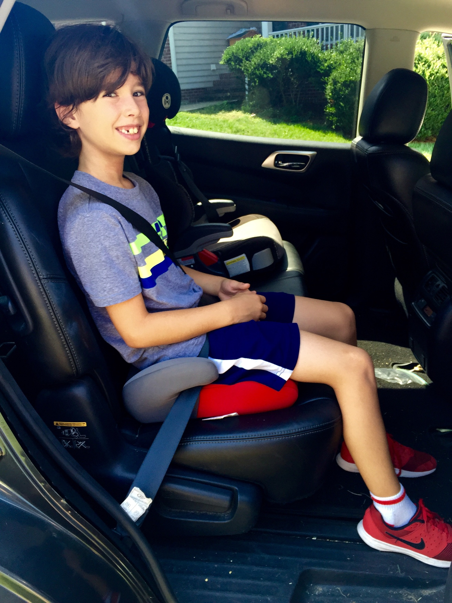 Boy In Booster Seat