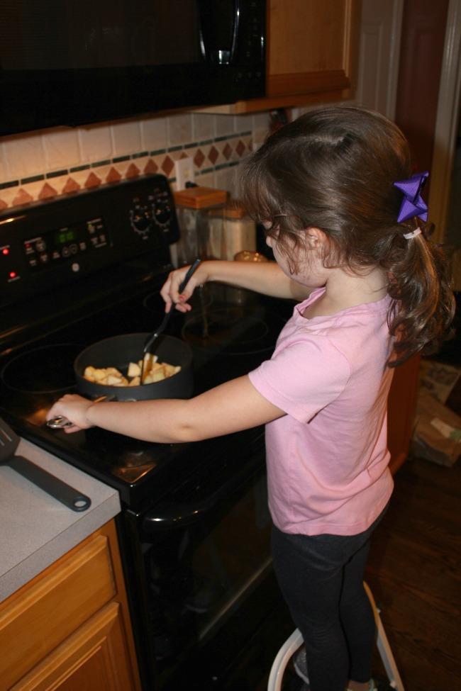 Helping make applesauce